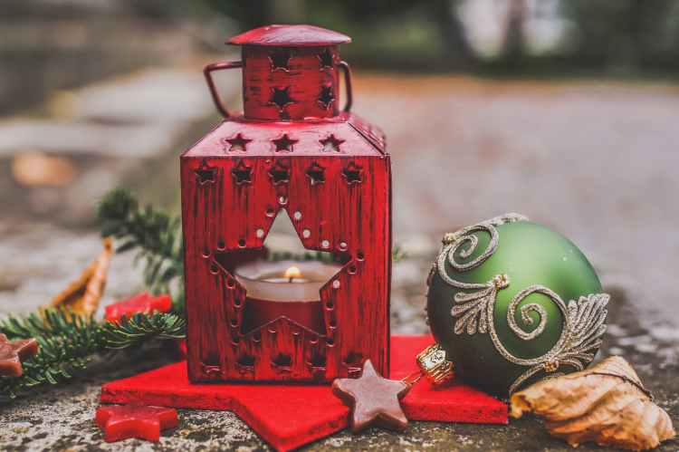 red sconces and green and gray bauble